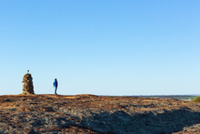 Hiker Atop Granite Outcrop Nex...