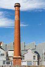 A Tall Brick Chimney Beside A ...