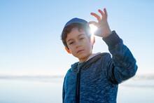 Boy Holding Light In His Finger Tips