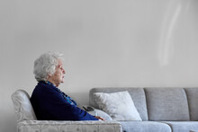 Elderly Lady Sitting On Couch ...