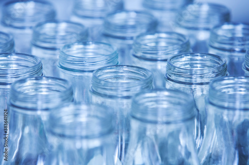 Photo Rows of glass bottles ready for recycling, shallow depth of fiel
