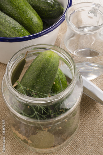 pickled gherkin with spice in a glass