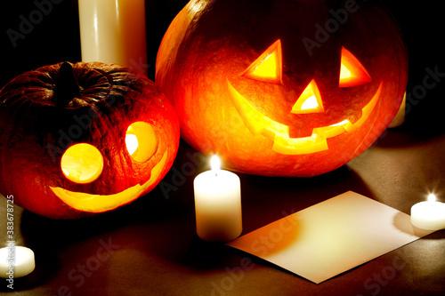 Halloween pumkins, candles and postcard