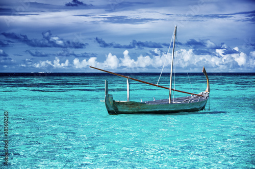 Little fishing boat in blue sea