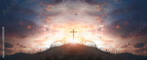 Fotomural cross religion symbol silhouette in grass over sunset  sky cross religion symbol