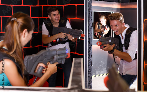 friends with plastic laser pistols in their hands playing laser tag (first-person view) Wallpaper Mural