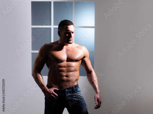 Fotografie, Obraz Strong man showing his perfect naked body. Bare torso.