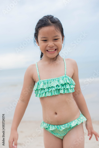 Little  girl playing on the beach on summer holidays Canvas Print