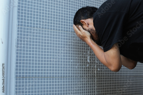 Fotografia, Obraz A moslem man take ablution, known as wudu, as one of ritual purification to pray