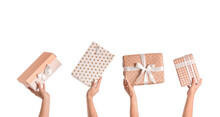 Hands With Gift Boxes On White...