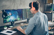 canvas print picture Rear back behind view of his he nice attractive busy focused guy geek playing web network game spending time at modern industrial interior loft concrete wall style work place station