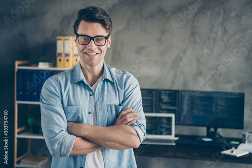 Obraz Close-up portrait of his he nice attractive cheerful cheery geek guy digital security top manager folded arms career growth at modern industrial interior style concrete wall work place station - fototapety do salonu