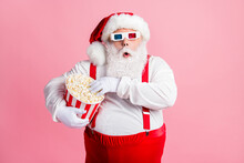 Portrait Of His He Nice Attractive Focused Amazed Funny Bearded Fat Santa Watching Film Eating Fast Fastfood Corn Spending Free Time Pastime Isolated Pink Pastel Color Background
