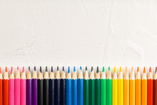 Colored Pencils In Row On A Wh...