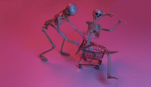 Scary Funny Skeletons With Shopping Trolley In Pink Blue Gradient Neon Light