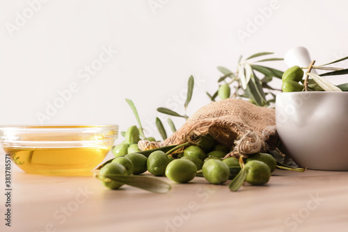Fototapeta Olive oil essence for body and culinary care front view obraz