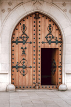 Old Wooden Door Decorated With Wrought Iron In European Small Town Closeup