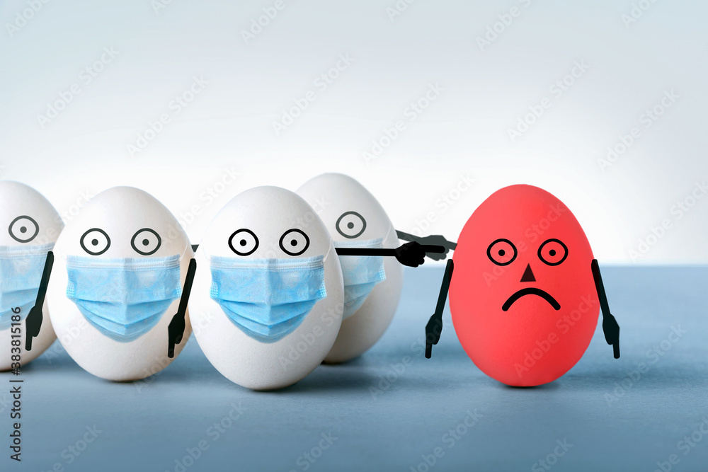 Fototapeta Eggs in medical masks condemn a red egg without a protective mask. Concept an irresponsible person ignores public rules during a viral disease epidemic.