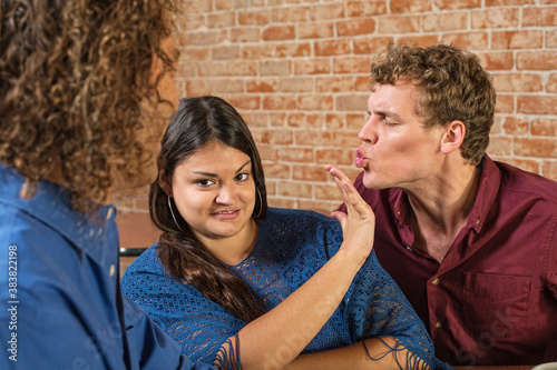 Fototapeta Man Kissing Annoyed Woman obraz