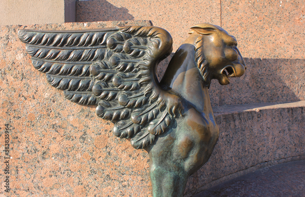 Fototapeta Bronze griffin sculpture at the Quay with Sphinxes in Saint Petersburg, Russia. Russian city landmark with griffin decorative statue outdoors, close up detailed view
