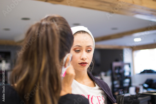 Fotografía Makeup application on young Caucasian girl with downcast eyes