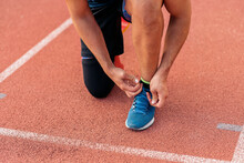 Closeup Athlete Tying Laces