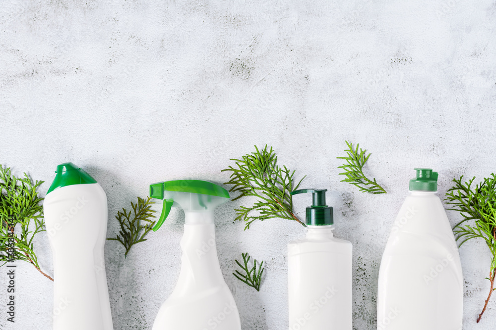 Fototapeta Set of different bottles of bio organic detergent  for home cleaning top view on grey concrete background.
