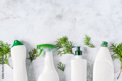 Obraz na plátně Set of different bottles of bio organic detergent  for home cleaning top view on grey concrete background