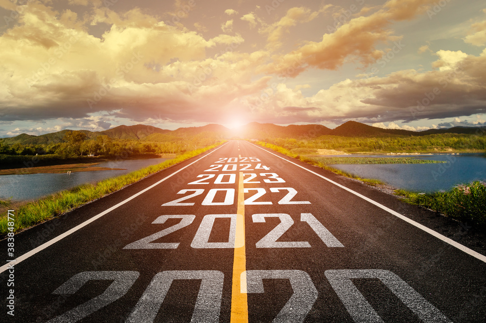 Fototapeta 2020-2025 written on highway road in the middle of empty asphalt road and beautiful blue sky. Concept for vision 2021-2025.