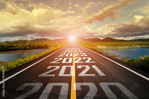 Fototapeta 2020-2025 written on highway road in the middle of empty asphalt road and beautiful blue sky. Concept for vision 2021-2025. obraz