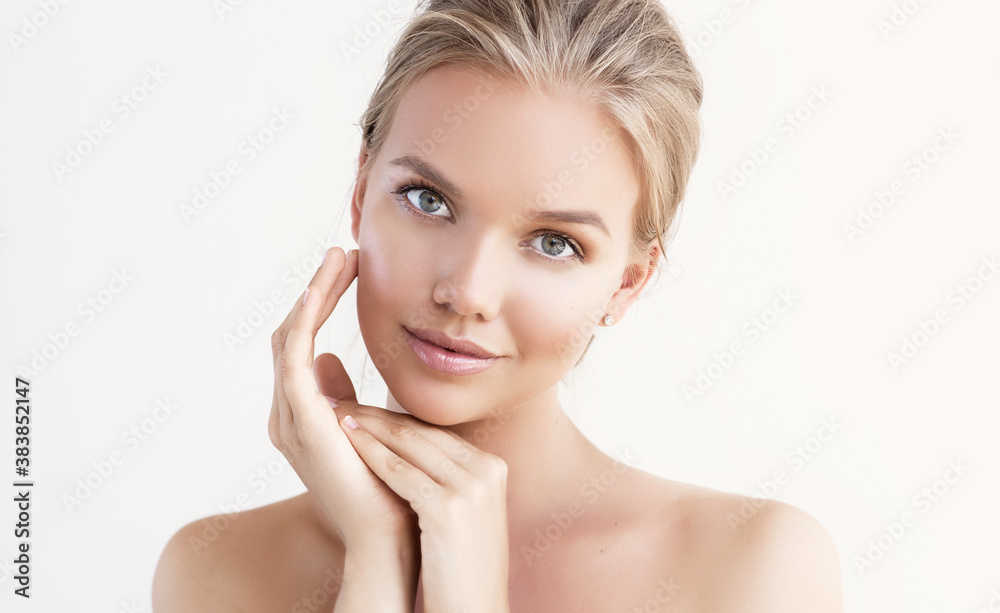 Fototapeta Beautiful young woman with clean fresh skin on face . Girl facial  treatment   . Cosmetology , beauty  and spa .
