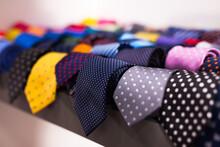 Row Of Neckties On Hangers In ...