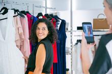 Happy Female Shoppers Enjoying...