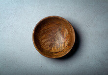Wooden Bowl On A Concrete Stone Surface. Texture And Texture Of Wood And Concrete.