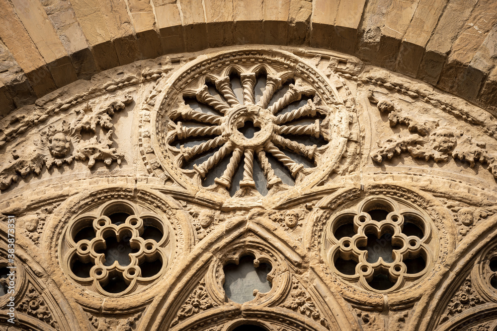 Architectural detail of the church of Orsanmichele in gothic style (1337-1380) in Florence downtown. Tuscany, Italy, Europe.