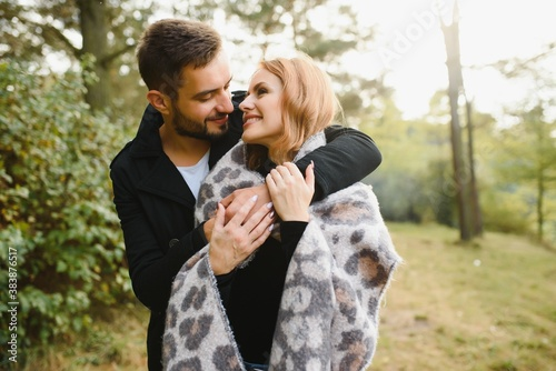 Photo of affectionate bonding couple hug cuddle in autumn september city center Canvas Print