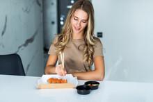 Young Woman Eating Sushi Asian...