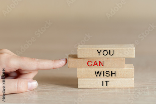 Fototapety, obrazy: finger pushes a wooden block from a pyramid with the inscription you can wish it