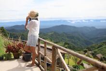 Asian Woman Travel At Mountain...