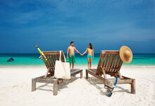 Couple In Green On A Beach At ...