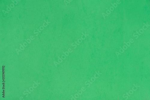 Photo Green glitter background with grain texture, pores, EVA foam (Ethylene Vinyl Ace