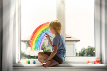 Little Boy Drawing Rainbow On ...