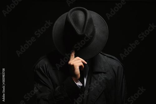 Obraz Old fashioned detective in hat on dark background - fototapety do salonu