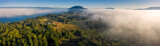 Aerial Panorama of Fog Rolling In Over an Island in the Pacific Northwest. Panoramic drone view of Lummi Island with fog coming in from both the east and the west.