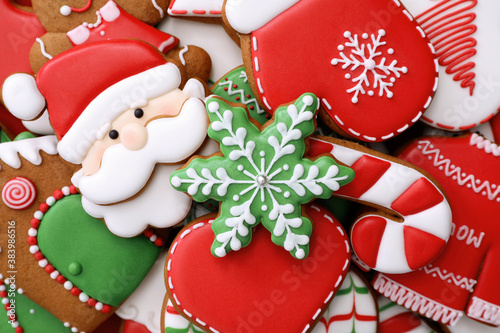 Different Christmas gingerbread cookies as background, top view