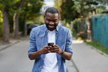 Happy Man Using Mobile Phone A...