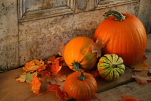 Pumpkins And Gourds At The Door