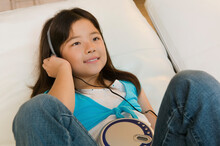 Girl Listening To Music On CD Player