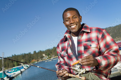 Fotografie, Tablou Man with Fishing Pole and Lure at Lake