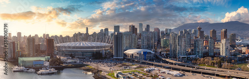 Downtown Vancouver, British Columbia, Canada. Aerial Panoramic View of a Modern Touristic City on the West Coast. Dramatic Colorful Sunset. Urban Cityscape Skyline
